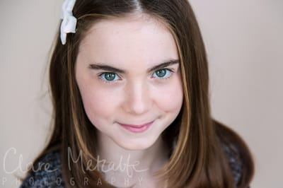 8 year old girl with green eyes smiling