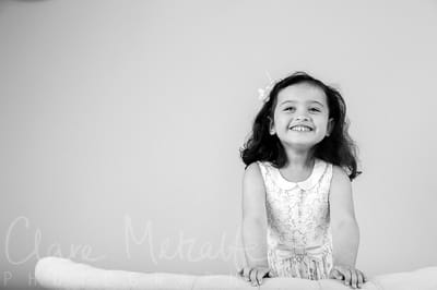 Black and white image of young girl grinning