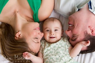 Baby with parents lying down