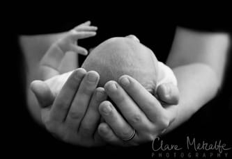 Newborn baby in Daddy's hands