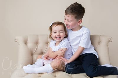 Siblings laughing