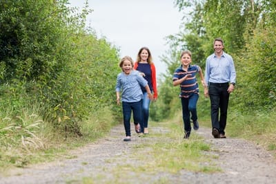 Photograph of family of found running down country lane.