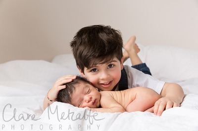 Newborn baby with big brother