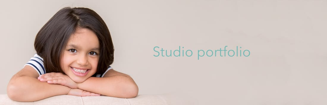 Photograph of girl resting head on hands, link to the studio family photography portfolio for Clare Metcalfe Photography